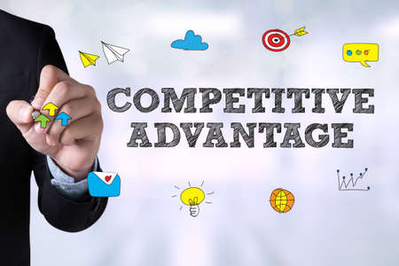 correlate: COMPETITIVE ADVANTAGE and Businessman drawing Landing Page on blackboard Stock Photo