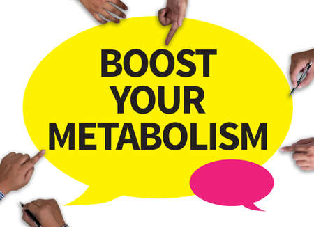 metabolism: BOOST YOUR METABOLISM with wooden frame on white background.