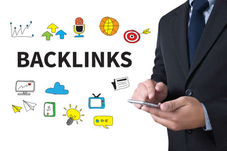 backlinks: BACKLINKS businessman working use smartphone Stock Photo