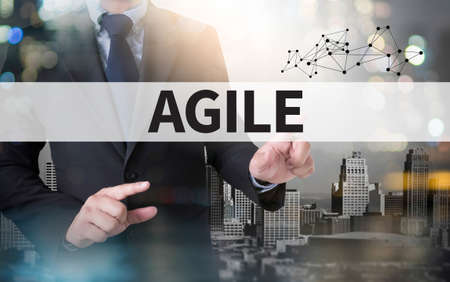 agile: Agile Agility Nimble Quick Fast Concept and businessman working with modern technology Stock Photo