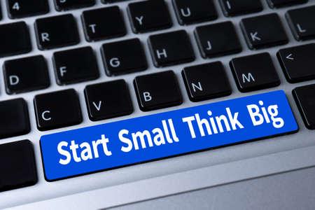 surpass: Start Small Think Big a message on keyboard
