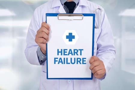 decreased: HEART FAILURE Portrait of a doctor writing a prescription Stock Photo