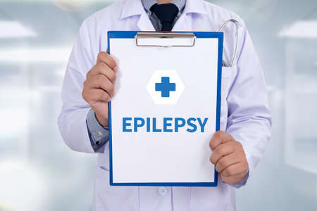 encephalopathy: EPILEPSY Portrait of a doctor writing a prescription