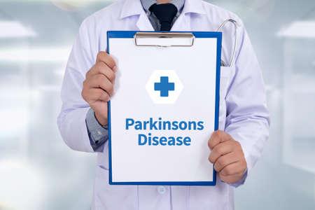 parkinson's: Parkinsons Disease Portrait of a doctor writing a prescription