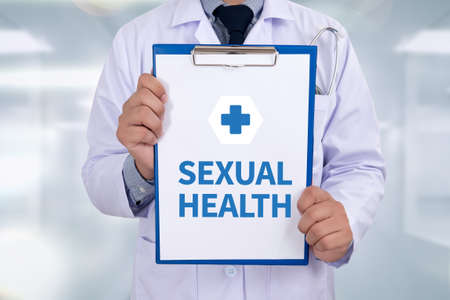sexual health: SEXUAL HEALTH Portrait of a doctor writing a prescription