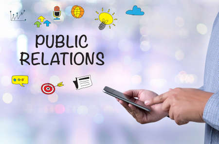 public folder: PUBLIC RELATIONS person holding a smartphone on blurred cityscape background
