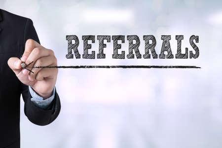 referidos: REFERRALS Businessman drawing Landing Page on blurred abstract background