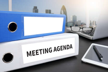 agenda: MEETING AGENDA Office folder on Desktop on table with Office Supplies.