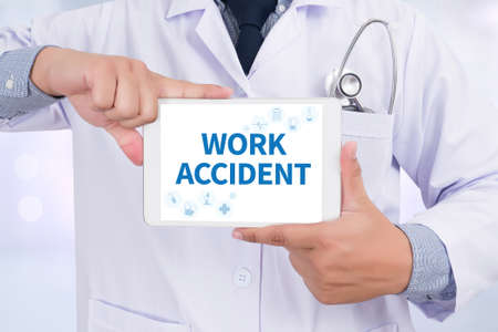 WORK ACCIDENT Doctor holding  digital tablet Stock Photo