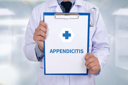 diverticulitis: APPENDICITIS Portrait of a doctor writing a prescription Stock Photo