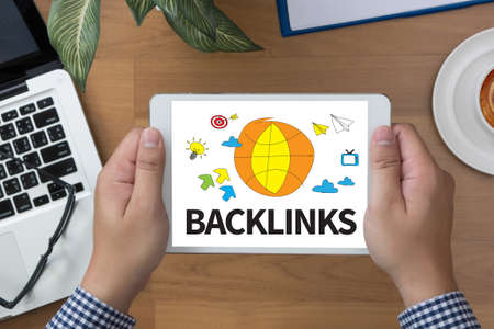 backlinks: Backlinks Technology Online Web man hand Tablet and coffee cup Stock Photo