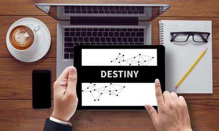 destiny: DESTINY CONCEPT vintage blackboard with wooden frame on white background., on the tablet pc screen held by businessman hands - online, top view