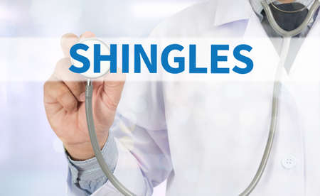 lesions: SHINGLES Medicine doctor hand working on virtual screen