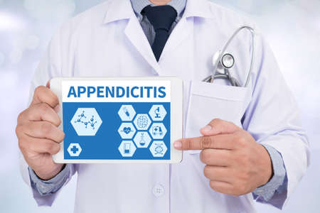 peritonitis: APPENDICITIS Doctor holding  digital tablet