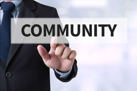 virtual community: COMMUNITY Businessman hands touching on virtual screen and blurred city background