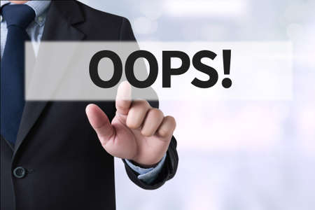 suprise: OOPS! Businessman hands touching on virtual screen and blurred city background