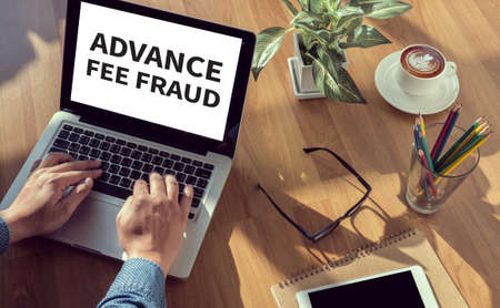 faked: ADVANCE-FEE FRAUD man hand on table Business, coffee, Split tone