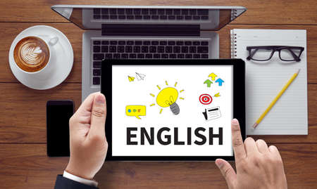 pronunciation: ENGLISH ( British England Language Education ), on the tablet pc screen held by businessman hands - online, top view