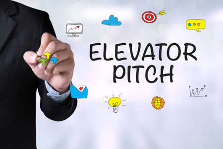 ELEVATOR PITCH and Businessman drawing Landing Page on blackboard Stock Photo - 56911546