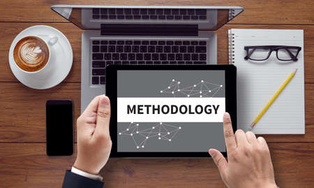 methodology: METHODOLOGY CONTEPT , on the tablet pc screen held by businessman hands - online, top view