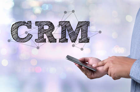 interactions: Business Customer CRM Management Analysis Service Concept  person holding a smartphone on blurred cityscape background