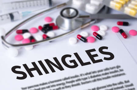 sores: SHINGLES and Background of Medicaments Composition, Stethoscope, mix therapy drugs doctor and selectfocus Stock Photo