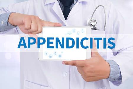peritonitis: APPENDICITIS Doctor holding  digital tablet