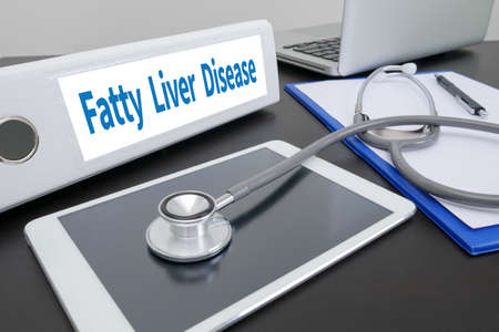 fatty liver: Fatty  Liver  Disease folder on Desktop on table.