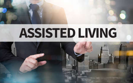 assisted living: ASSISTED LIVING and businessman working with modern technology
