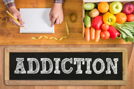 habituation: ADDICTION fresh vegetables and  on a wooden table