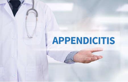 diverticulitis: APPENDICITIS Medicine doctor hand working Stock Photo