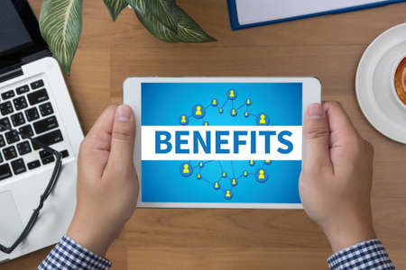 additional compensation: BENEFITS man hand Tablet and coffee cup