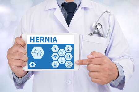 hernia: HERNIA Doctor holding  digital tablet