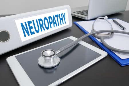 involuntary: NEUROPATHY folder on Desktop on table.