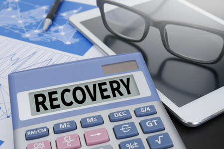 data recovery: RECOVERY (Recovery Backup Restoration Data) Calculator  on table with Office Supplies.