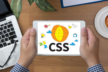 css: CSS Web Online Technology Web Design man hand Tablet and coffee cup