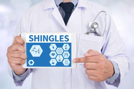 sores: SHINGLES Doctor holding  digital tablet