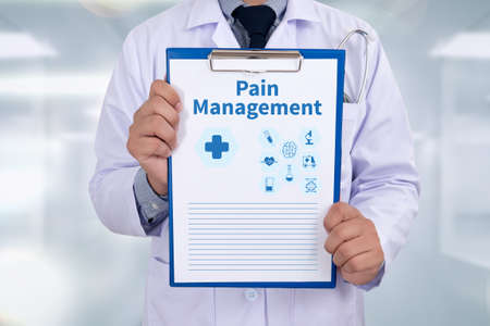 pain management: Pain Management Portrait of a doctor writing a prescription