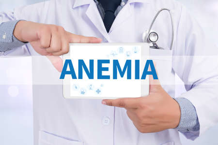 anemia: ANEMIA Doctor holding  digital tablet