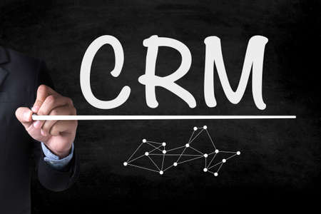 interactions: Business Customer CRM Management Analysis Service Concept  and Businessman drawing  Page on blackboard