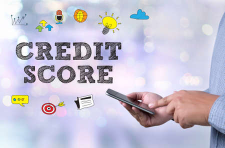 accounting records: CREDIT SCORE person holding a smartphone on blurred cityscape background