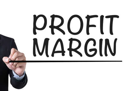 margen: PROFIT MARGIN  Businessman hand writing with black marker on white background