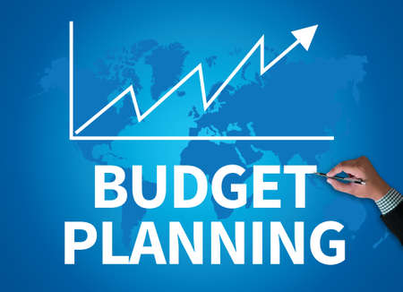 marginal: BUDGET PLANNING businessman work on white broad, top view Stock Photo