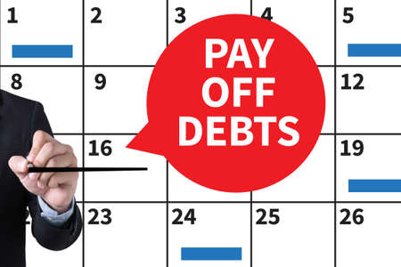 pay off: PAY OFF DEBTS Loan Money Bankruptcy Bill  Businessman hand writing with black marker on white background