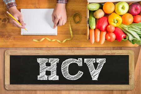 genotype: HCV  fresh vegetables and  on a wooden table