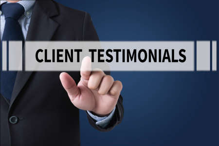 affirmations: CLIENT TESTIMONIALS Businessman hands touching on virtual screen and blurred city background