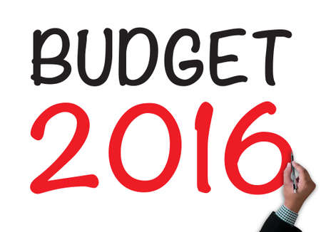 BUDGET 2016 businessman work on white broad, top view