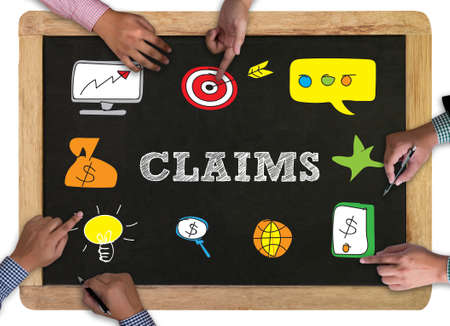 claims: CLAIMS CONCEPT vintage blackboard with wooden frame on white background. Stock Photo