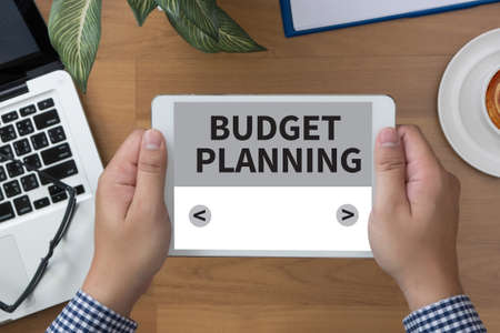 bankroll: BUDGET PLANNING man hand Tablet and coffee cup