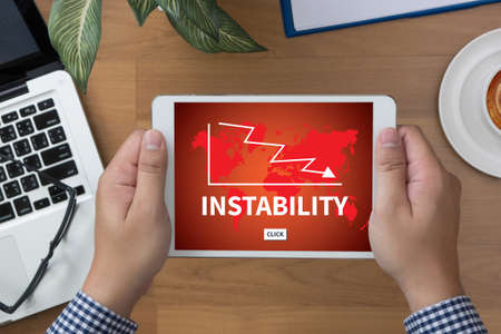 instability: INSTABILITY man hand Tablet and coffee cup
